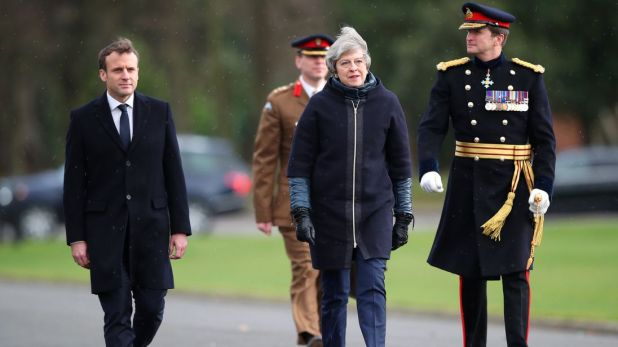 France's President Emmanuel Macron and Britain's Prime Minister Theresa May arrive at Sandhurst Military Academy