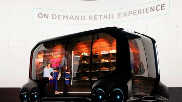 "Toyota displays the ""e-Pallete"", a new fully self-driving electric concept vehicle designed to be used for ride hailing, parcel delivery services and other uses"