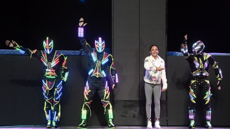 Members of Zero Gravity Arts wearing custom-engineered LED costumes perform before a keynote address by Intel CEO Brian Krzanich