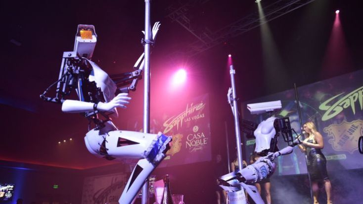 Stripper robots perform at the Sapphire Gentlemen's Club on the sidelines of CES 2018 in Las Vegas on January 8, 2018. / AFP PHOTO / Mandel Ngan (Photo credit should read MANDEL NGAN/AFP/Getty Images)