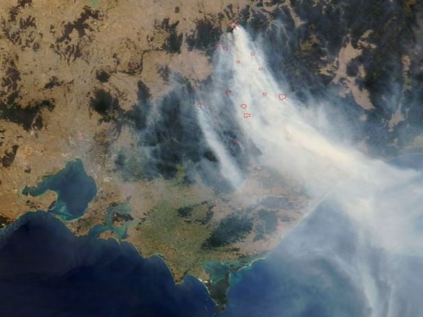 IN SPACE - DECEMBER 7: This satellite image from NASA taken on December 5, 2006 shows smoke from bush fires in southeastern Australia. At left is Melbourne and Port Phillip Bay. Thirty-seven bushfires, thought to have been sparked by lightning, have joined together to become 15 large fires. They have burnt approximately 90,000 hectares of scrub and forest and continue to spread in the southern Australian state of Victoria. Officials predict the fires might burn out as much as 600,000 hectares by