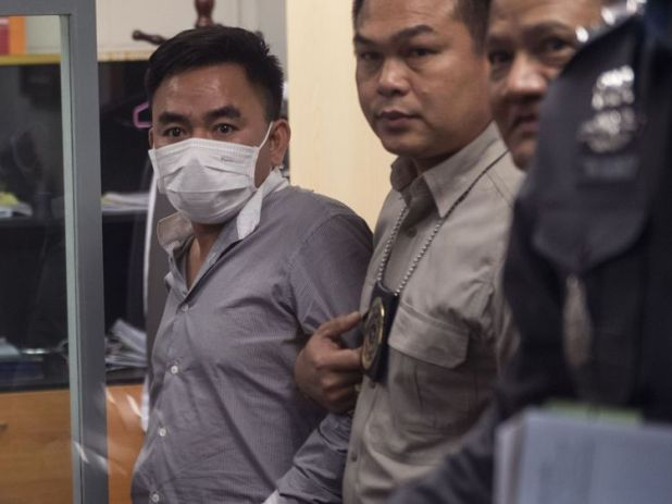 Boonchai Bach, 40, a Vietnamese national with Thai citizenship and alleged kingpin in Asia's illegal trade in endangered species, is handled by Thai police in Bangkok after his arrest on January 20, 2018