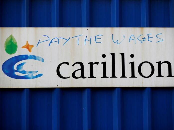 Defaced branding is seen outside Carillion's Royal Liverpool Hospital site  Carillion workers and union sue for back pay skynews carillion pay the wages graffiti 4206948