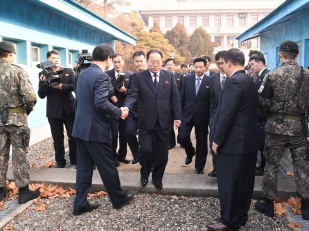 Head of North Korean delegation Jon Jong Su, crosses the concrete border to attend their meeting at the truce village of Panmunjom in the demilitarised zone separating the two Koreas, South Korea, January 17, 2018. Yonhap/Reuters