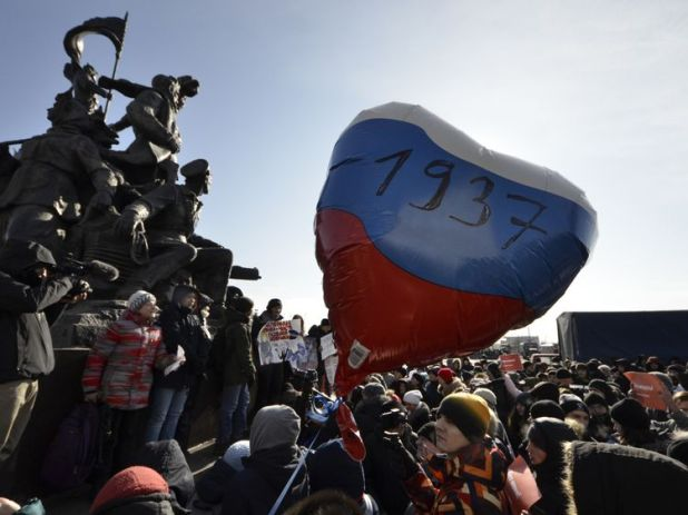 Supporters of Navalny attend a rally for a boycott of the presidential election in the far eastern city of Vladivostok