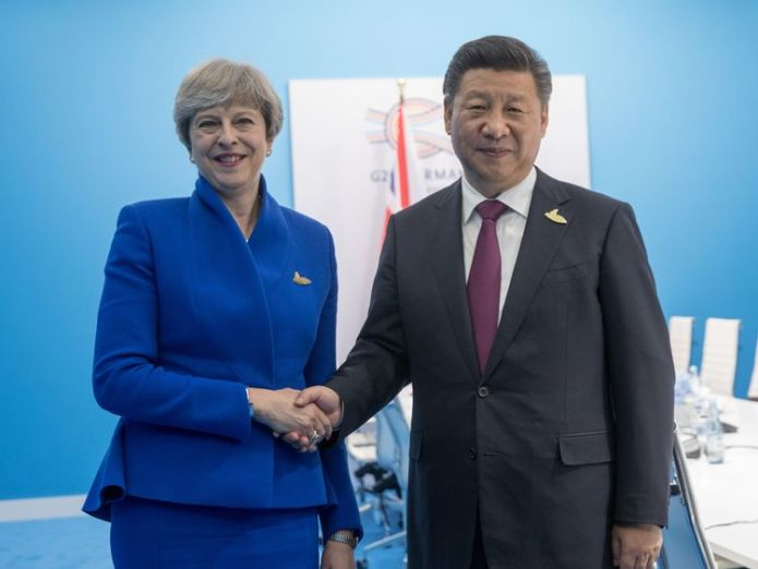 Theresa May is in China for post-Brexit trade talks. File pic Is China's leader Xi Jinping doing a Vladimir Putin by clinging to power? Is China's leader Xi Jinping doing a Vladimir Putin by clinging to power? skynews theresa may china xi jinping 4218228