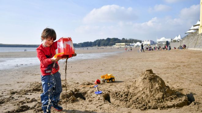 Jimi Cooke, 5, from Vale of Glamorgan, plays on Barry Island beach in South Wales during sunny weather as temperatures remain in single figures