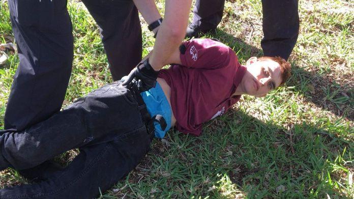 Police detain Nikolas Cruz at the scene of the Parkland school shooting Florida school gunman Nikolas Cruz 'remorseful' and 'sad' Florida school gunman Nikolas Cruz 'remorseful' and 'sad' skynews florida shooting gun violence 4232045