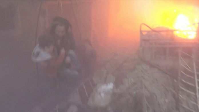 A teenager screams for his father in this video and rescuers help people climb out of the rubble of a building, where a fire is actively burning. The Syrian Civil Defense said this video was filmed in Saqba.  UN calls Syria 'prolific slaughterhouse' as it calls for ceasefire UN calls Syria 'prolific slaughterhouse' as it calls for ceasefire skynews ghouta syria assad 4238551