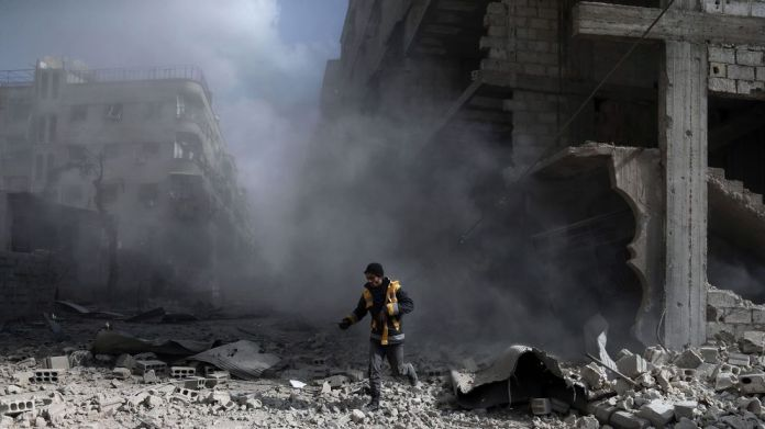 A White Helmets volunteer in the aftermath of an air raid in Saqba, eastern Ghouta Airstrikes follow UN ceasefire vote but relative calm returns Airstrikes follow UN ceasefire vote but relative calm returns skynews syria ghouta 4239344