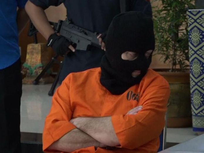 The German was allegedly caught with drugs including heroin Briton appears in balaclava and flanked by armed police after Bali drug arrest Briton appears in balaclava and flanked by armed police after Bali drug arrest skynews bali drugs siegfried karl achim 4237626