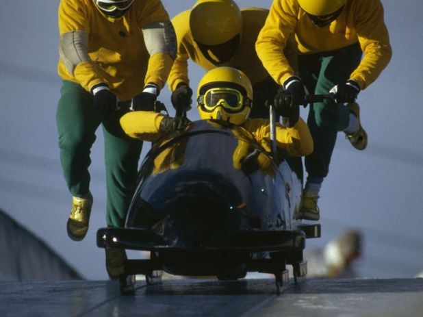 CALGARY - FEBRUARY 25: The Jamaican four man bobsleigh team in action at the 1988 Calgary Winter Olympic Games held on February 25, 1988 in Calgary, Canada. (Photo by David Yarrow/Getty Images)