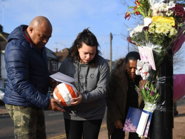 Grandfather Kim May and other family placed tributes at the scene