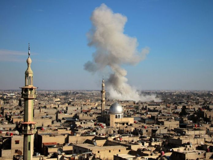 Smoke rises from buildings following government bombardment on the outskirts of the capital Damascus 'Deadliest day' in years as women and children killed near Damascus 'Deadliest day' in years as women and children killed near Damascus skynews damascus syria government airstrikes 4235824