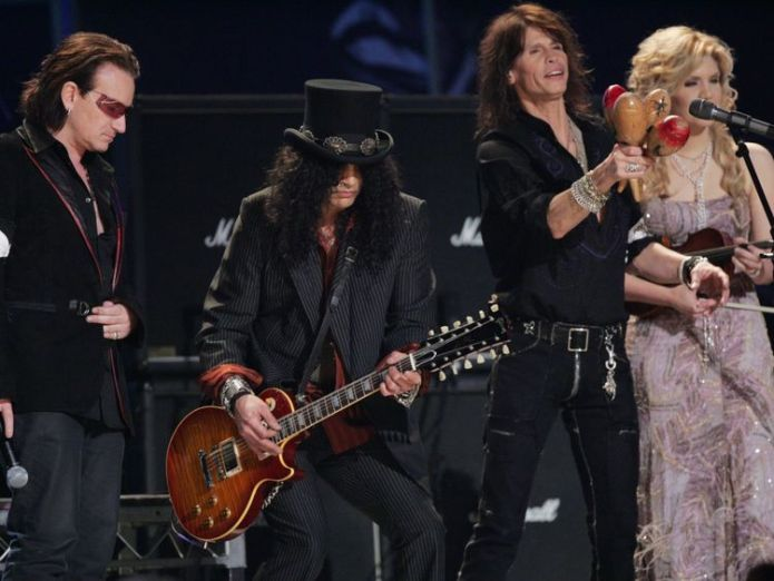 Musicians Bono, Slash, Steven Tyler and Allison Krauss perform with a Gibson guitar Iconic guitar company Gibson could be facing bankruptcy Iconic guitar company Gibson could be facing bankruptcy skynews gibson guitar bono 4234907