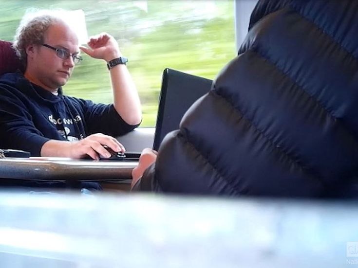 Photo issued by the National Crime Agency of a still taken from surveillance footage of Matthew Falder on a train
