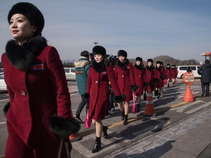 North Korea's official cheerleaders arrive in South Korea for the winter Olympics Path to peace is paved with photo ops Path to peace is paved with photo ops skynews north korea olympics 4225095