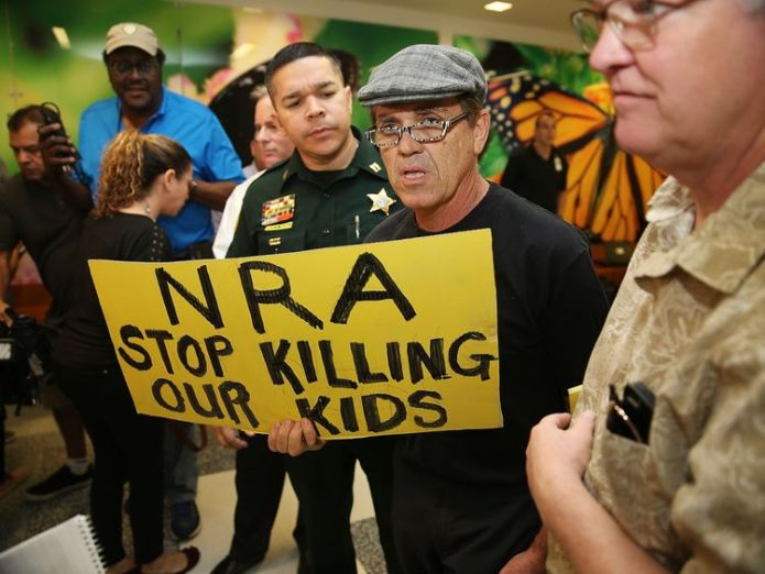 A protester holds a sign that reads 'NRA Stop Killing Our Kids' following the Florida massacre I've told NRA school shooting 'nonsense' has to stop I've told NRA school shooting 'nonsense' has to stop skynews nra florida shooting 4239596