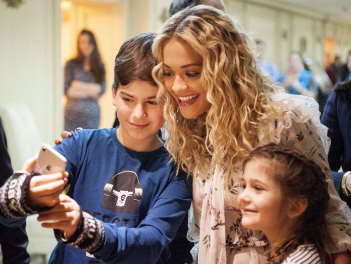The singer's young fans were keen to grab a selfie upon her arrival Singer Rita Ora jets to Kosovo for independence party Singer Rita Ora jets to Kosovo for independence party skynews rita ora kosovo 4233876