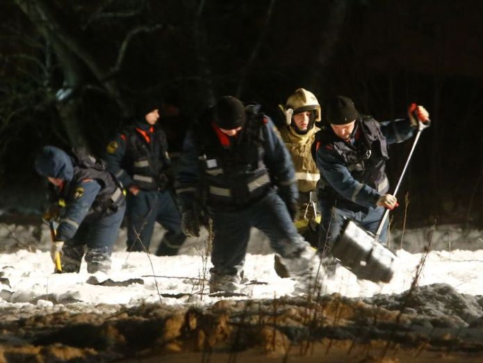 Rescue workers combing the crash site
