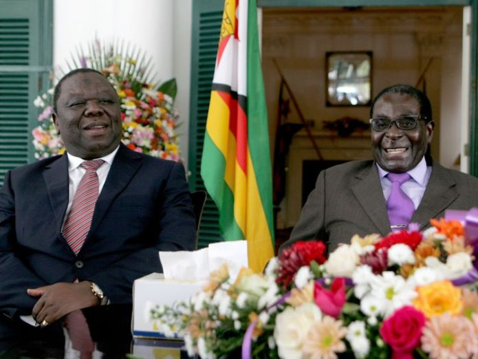 Zimbabwe's President Robert Mugabe (R) and Prime Minister Morgan Tsvangirai (L) announce the conclusion of the constitution making process at State House on January 17, 2013 in Harare. Mugabe said the country has concluded writing a draft constitution after all political parties agreed to the charter that is set to go for a referendum before elections this year. Mugabe and Tsvangirai formed a power-sharing government three years ago after violent and disputed polls in 2008. Their relations have  Zimbabwe opposition leader Tsvangirai dies Zimbabwe opposition leader Tsvangirai dies skynews tsvangirai mugabe zimbabwe 4231259