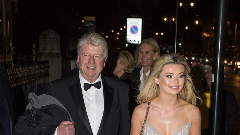Stanley Johnson, father of Boris Johnson, and Georgia Toffolo, reality TV star, arrive for the Conservative party Black and White Ball at Natural History Museum on February 7, 2018 in London, England.