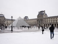 The Louvre Pyramid after overnight snowfall in Paris  Ireland on red alert as 'extraordinary' storm approaches Ireland on red alert as 'extraordinary' storm approaches skynews europe snow france 4243819