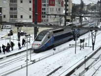 Passengers walk out a TGV train blocked by snow in Montpellier in the south of France Ireland on red alert as 'extraordinary' storm approaches Ireland on red alert as 'extraordinary' storm approaches skynews europe snow france 4243847