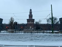 A snow-covered sidewalk in front of Sforzesco Castle in Milan  Ireland on red alert as 'extraordinary' storm approaches Ireland on red alert as 'extraordinary' storm approaches skynews europe snow italy 4243818