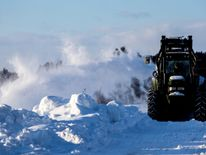 A snow plough clears the road in Soerum, north of Oslo, Norway Ireland on red alert as 'extraordinary' storm approaches Ireland on red alert as 'extraordinary' storm approaches skynews europe snow norway 4243781