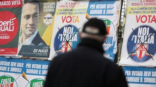 A man stands to look electoral posters in Pomigliano D'Arco, near Naples, Italy, February 21, 2018 Stock markets across Europe rattled by Italy crisis Stock markets across Europe rattled by Italy crisis skynews pomigliano darco naples 4247066