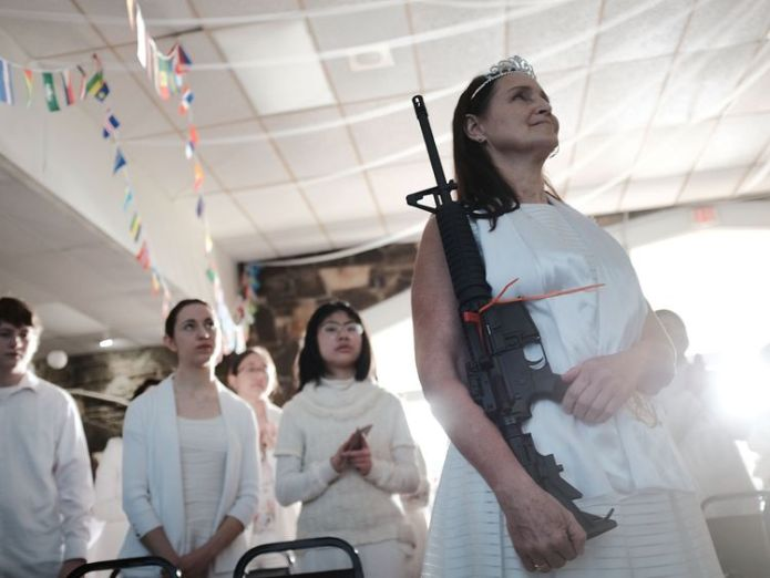 A woman holds an AR-15 rifle during the blessing Worshippers armed with AR-15s celebrate their marriages and weapons at a church in Pennsylvania Worshippers armed with AR-15s celebrate their marriages and weapons at a church in Pennsylvania guns church us sky news 4243550