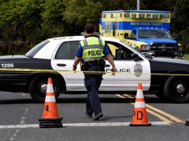 Members of Austin Police Department block off part of Republic of Texas Boulevard following an explosion in Austin, Texas, U.S., March 19, 2018