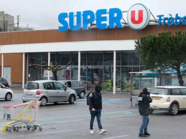 Forensics work in front of the Super U supermarket in Trebes, southwestern France