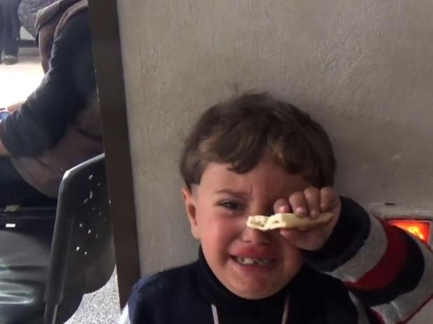 A child cries in a hospital in Afrin, Syria