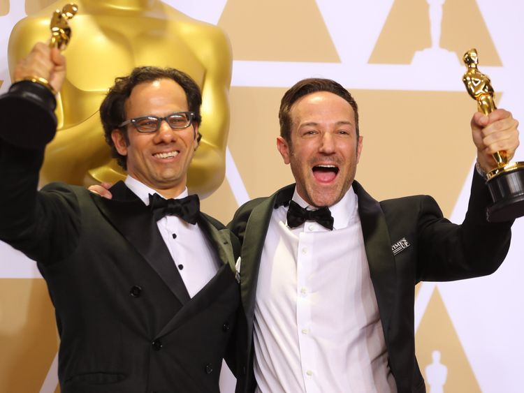 "Dan Cogan (L) and Bryan Fogel pose with their Oscars after winning Best Documentary for ""Icarus"""