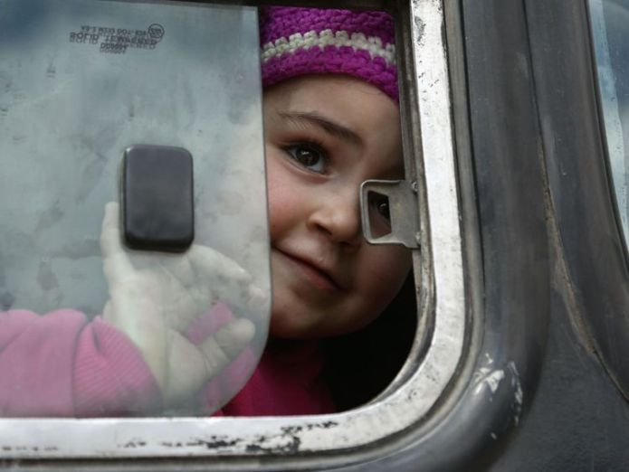 A Syrian girl opens the bus window after being evacuated from Eastern Ghouta on Sunday Syrian government says Damascus and surrounds 'free from militants' Syrian government says Damascus and surrounds 'free from militants' skynews syria eastern ghouta 4264834