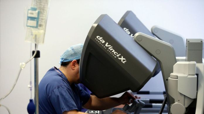 Surgery by robot is less invasive than open surgery