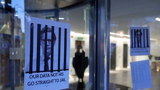 Posters depicting Cambridge Analytica's CEO Alexander Nix behind bars at the entrance of the company's London offices Row develops over Mark Zuckerberg's closed evidence session to EU Row develops over Mark Zuckerberg's closed evidence session to EU skynews cambridge analytica 4285348