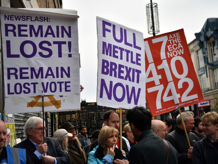 Pro-Brexit demonstrators gather outside the launch oF the Peoples Vote campaign