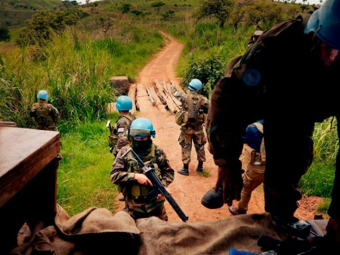UN peacekeeping soldiers return to their patrol vehicle in the Djugu area of Iuri Girl, 10, shares horror of rape amid humanitarian crisis in DR Congo Girl, 10, shares horror of rape amid humanitarian crisis in DR Congo skynews iuri djugi congo un 4280241