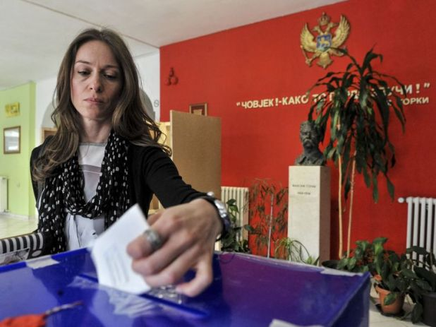 A woman casts her ballot in the presidential election at a polling station in Podgorica