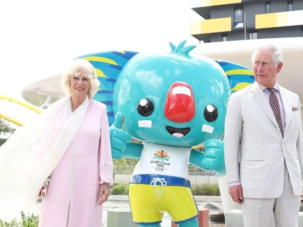 Prince Charles and Camilla with the official Commonwealth Games mascot Borobi at the athletes village