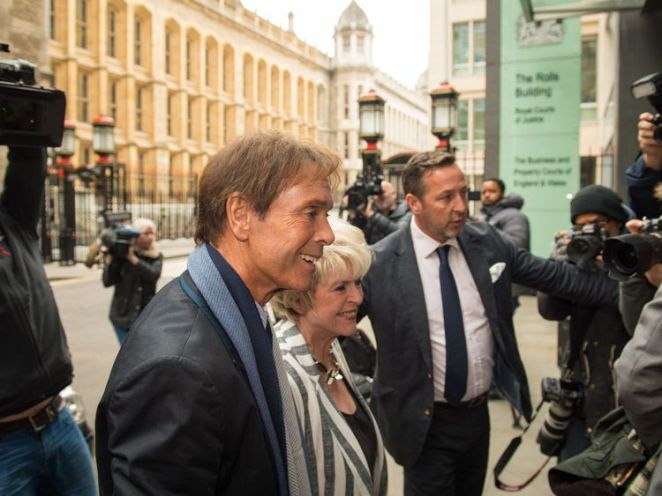 Sir Cliff Richard enters the High Court for his second day of a trial against the BBC
