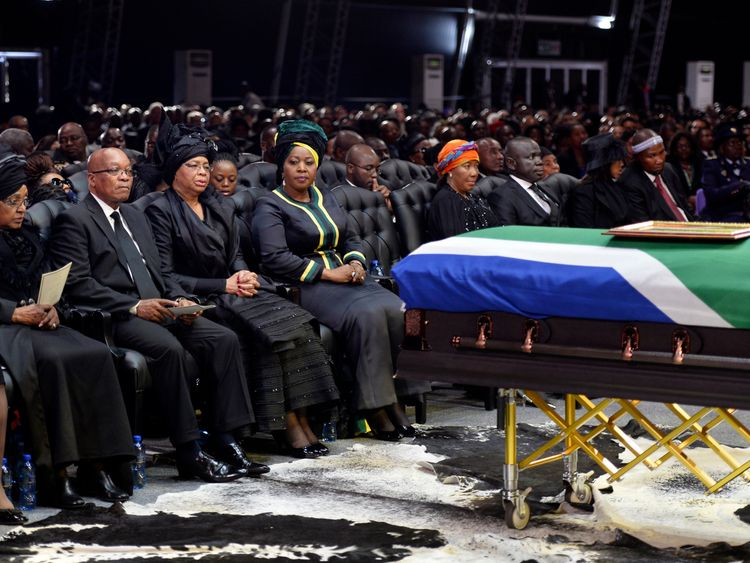 Winnie Mandela (L) and former South Africa president Jacob Zuma at Nelson Mandela's funeral in 2013