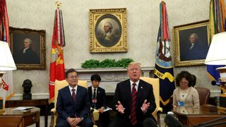 U.S. President Donald Trump welcomes South Korea's President Moon Jae-In in the Oval Office of the White House in Washington, U.S., May 22, 2018.  North Korea brands Mike Pence 'stupid' as it warns of 'nuclear showdown' with US North Korea brands Mike Pence 'stupid' as it warns of 'nuclear showdown' with US skynews trump korea moon 4317593