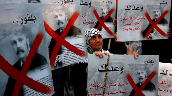 Palestinian demonstrators carry placards of British Prime Minister Balfour while protesting the Balfour Declaration What is Nakba Day? What is Nakba Day? skynews balfour declaration 4310701