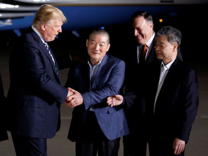 Donald Trump greets the Americans formerly held hostage in North Korea upon their arrival at Joint Base Andrews Donald Trump hails Kim Jong Un as North Korea prisoners arrive home Donald Trump hails Kim Jong Un as North Korea prisoners arrive home skynews donald trump prisoners hostages 4305467