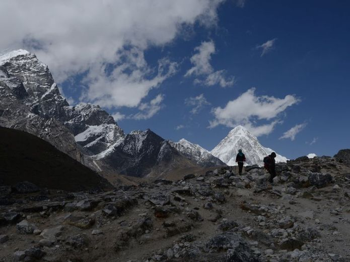 Trekkers walk to Everest Base Camp. File photo Sherpa reaches summit of Everest for the 22nd time Sherpa reaches summit of Everest for the 22nd time skynews everest mountain 4312252