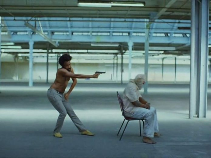 Gambino adopts what could be portrayed as a Jim Crow stance What's behind the music video taking the world by storm? What's behind the music video taking the world by storm? skynews gambino childish gambino 4303864